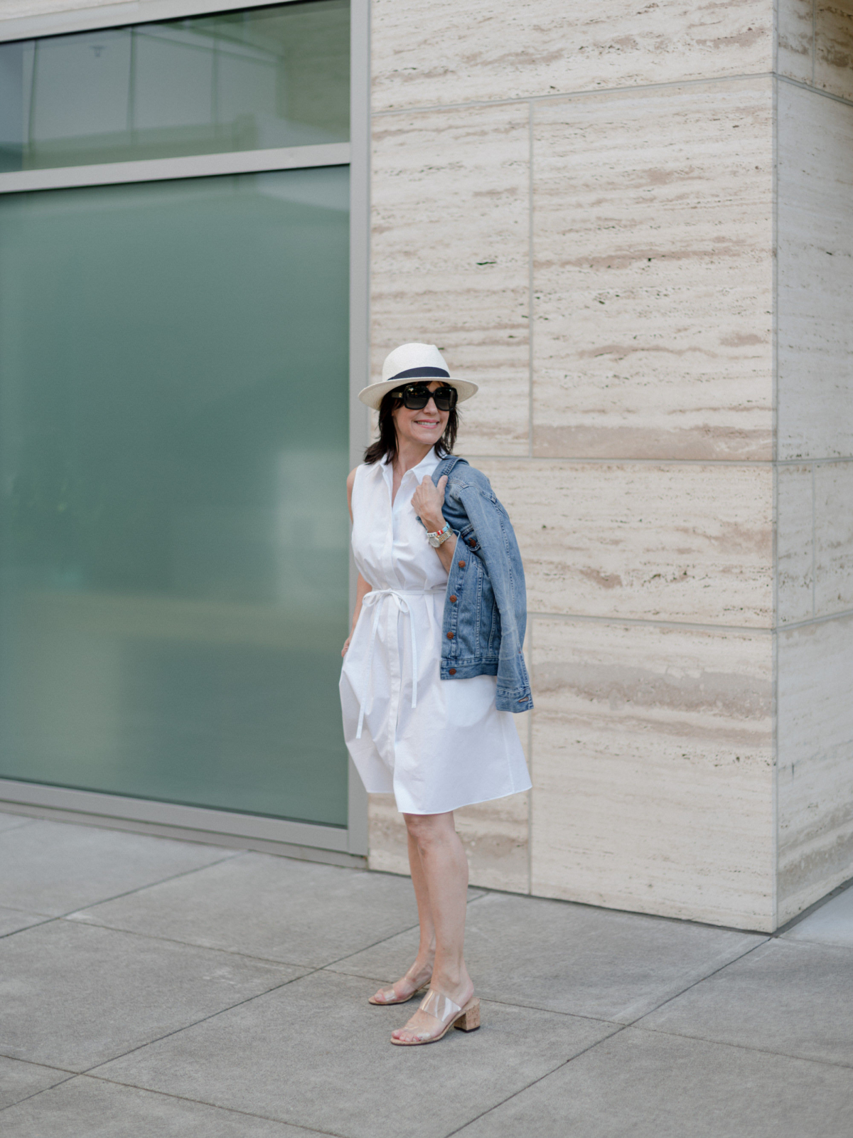 Fashion blogger wearing a shirt dress as a best summer item