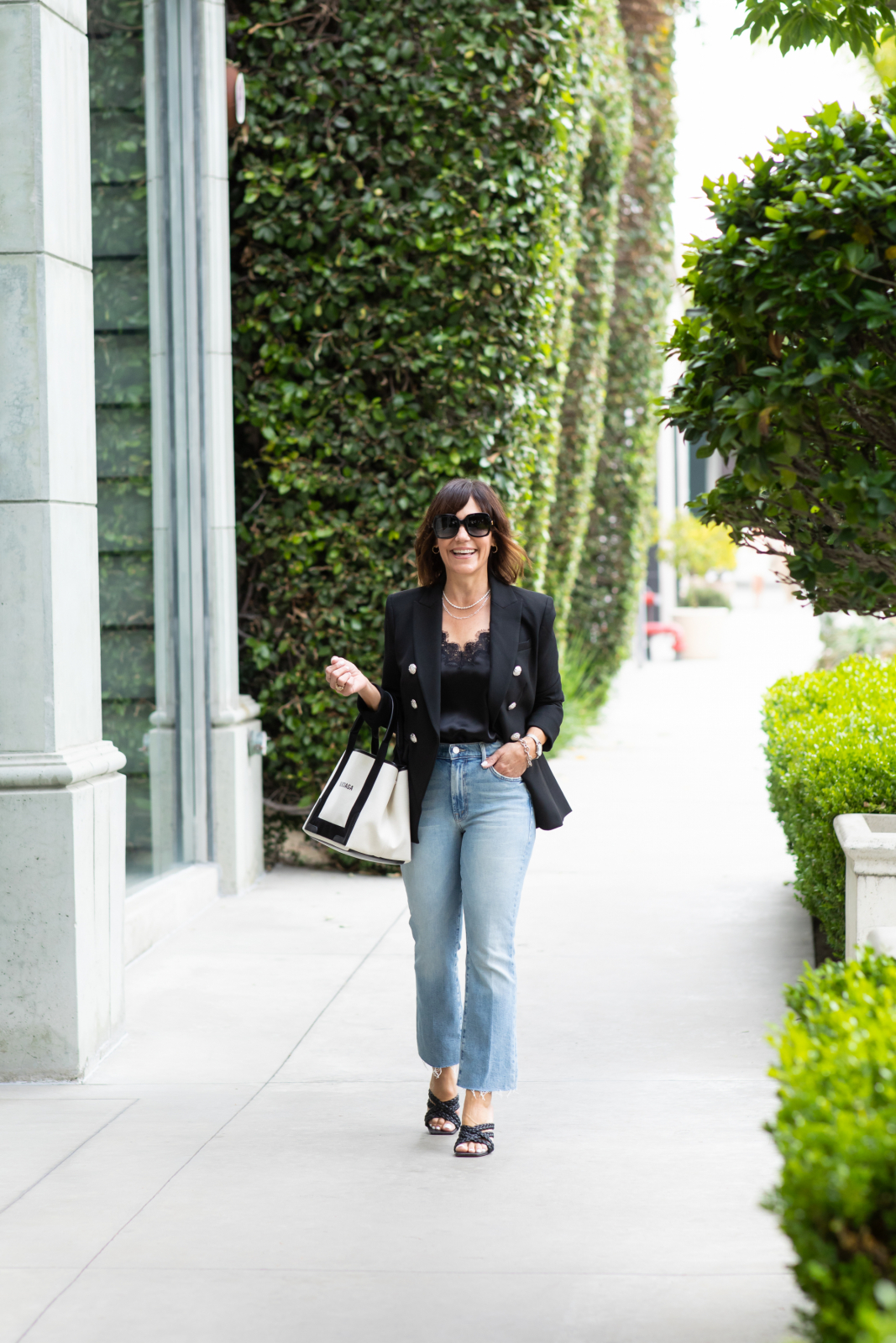 Veronica Beard Blazer, Balenciaga handbag, black sandals, Mother denim, sunglasses, NYC cami